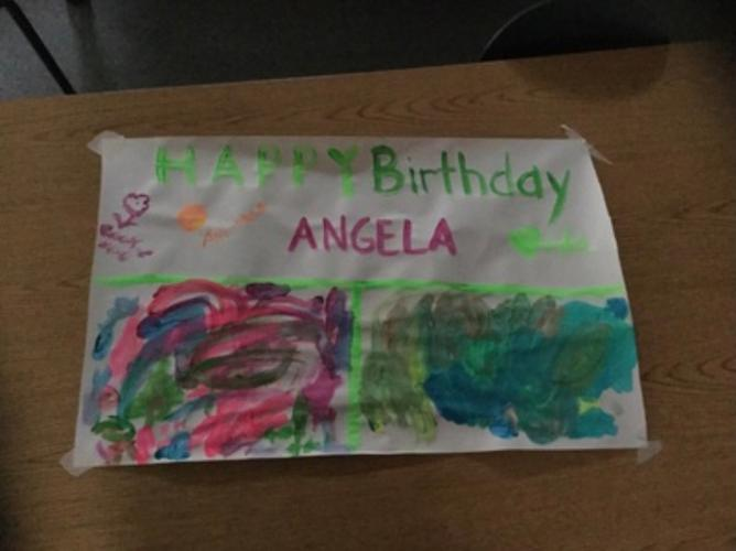 We sang Happy Birthday to Miss Angela! The Ivy Owls made her a bday banner!
